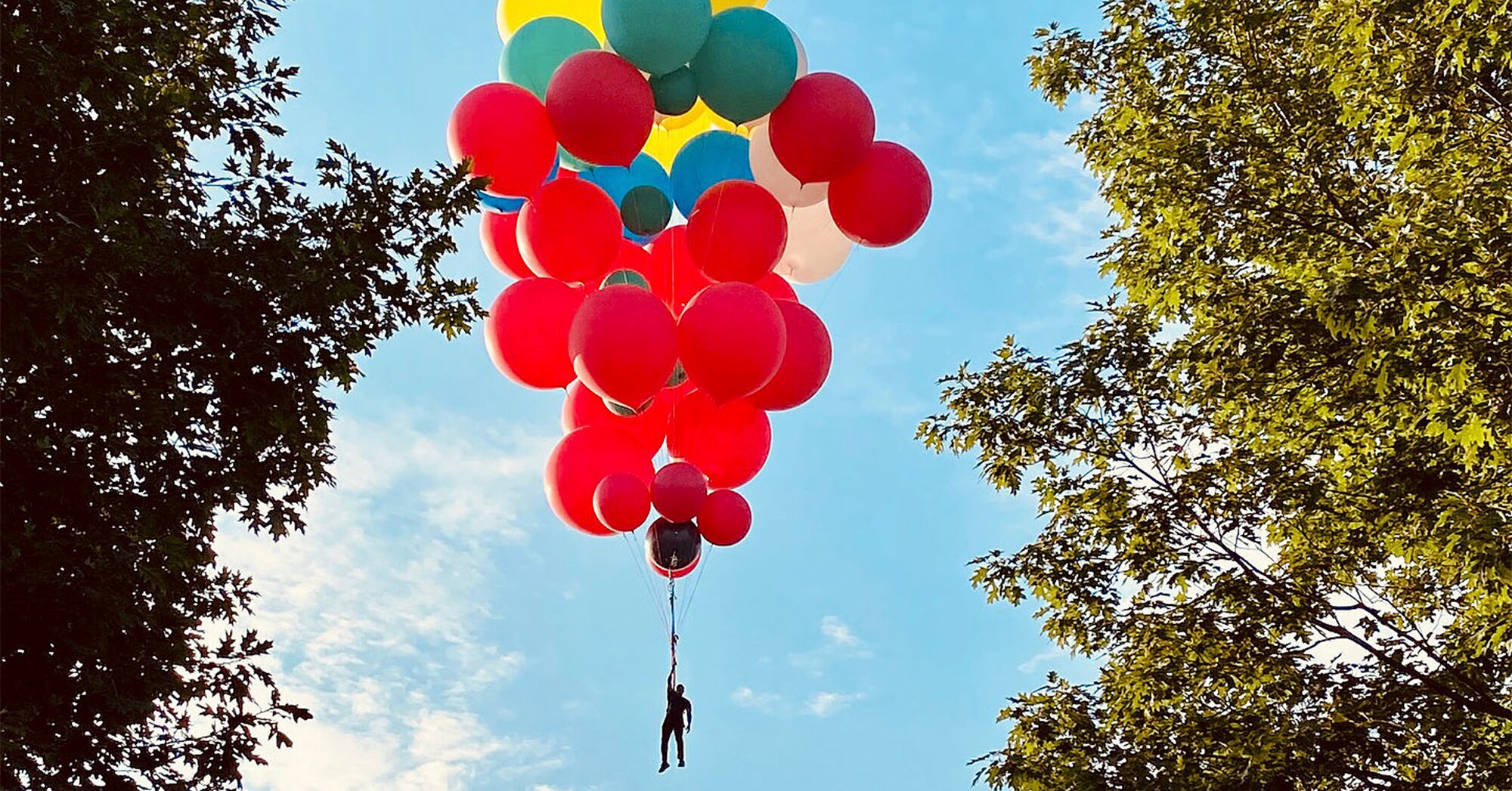 American Magician And Daredevil David Blaine Soars Into the Skies Using Helium Balloons